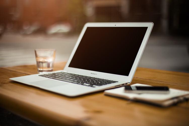 Quiet Office Scene Laptop Notebook Pen