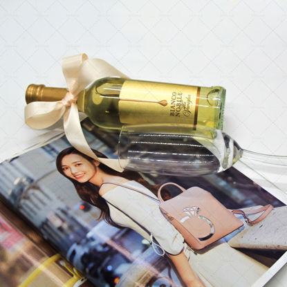 Golden champagne,gift,ribbon,champagne glass,magazine