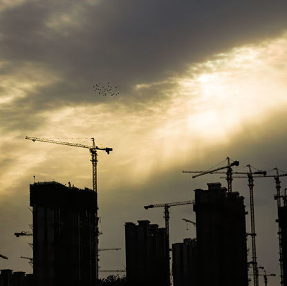 Photos of buildings under construction in backlight